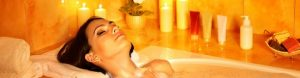 image of lady relaxing in a bath